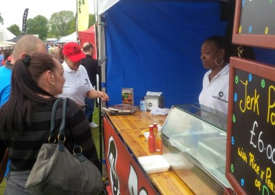 Natalie and customers at Roti Kitchen Stall