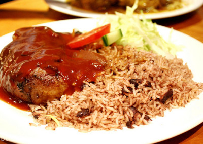 authentic looking Jerking chicken with rice and peas